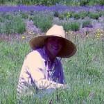 Younes smiles in field
