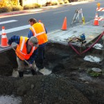 Andrew's Landscaping reparing hole for replacement of water main cross