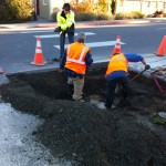 Preparing hole for replacement of water main cross